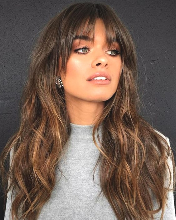70s wispy bangs fall haircut trends
