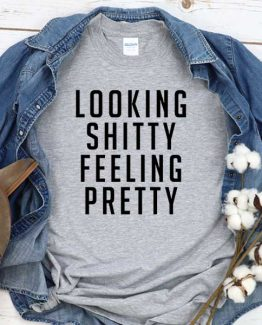 T-Shirt Looking Shitty Feeling Pretty men women crew neck tee. Printed and delivered from USA or UK