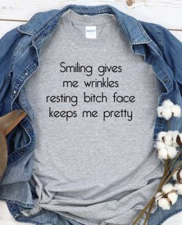 T-Shirt Smiling Gives Me Wrinkles Resting Bitch Face Keeps Me Pretty men women round neck tee. Printed and delivered from USA or UK